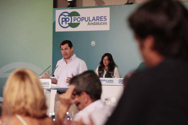 Moreno, en una reunión de su partido en Granada.