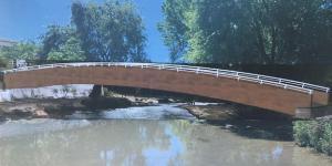 Fotomontaje de cómo quedará la pasarela sobre el río.