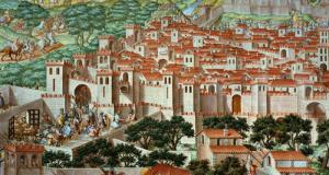 Granada en 1126. Los cruzados aragoneses debieron ver una ciudad amurallada, sólo con la Alcazaba de la Alhambra, y sumamente poblada (unos 60.000 habitantes).