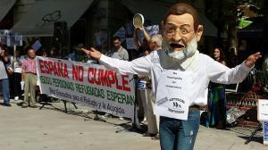 'España no cumple', se podía leer en la pancarta que ha presidido la acción.