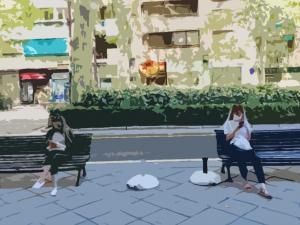 Dos jóvenes, pendientes de sus móviles, en una imagen retocada.