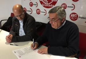 Juan Francisco Martín y Luis Romero en la firma del convenio.