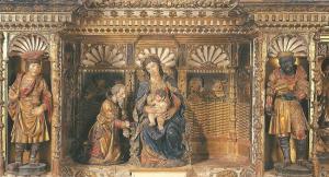 La figura del Emperador Carlos V aparece como rey Gaspar (izquierda) en el gran retablo mayor de la Capilla Real de Granada.