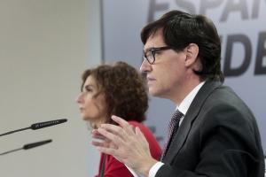 Los ministros Salvador Illa y María Jesús Montero, este martes en rueda de prensa.