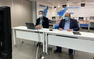 Carlos Rojas y José Robles, en la sede del PP, durante el encuentro telemático.