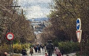 Vista retocada del paseo de la Constitución con el Albaicín y Sierra Nevada al fondo.